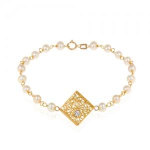 دستبند طلا زنانه طرح فیوژن لوزی با نگین و مروارید کد xb716