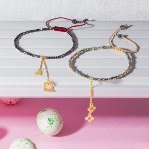 دستبند سنگ با آویز طلا طرح گل کد XB972